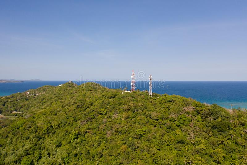 Telecommunication tower, communication antenna. Landscape with hills and rainforest, view from above. Telecommunication tower, communication antenna. Repeaters royalty free stock images