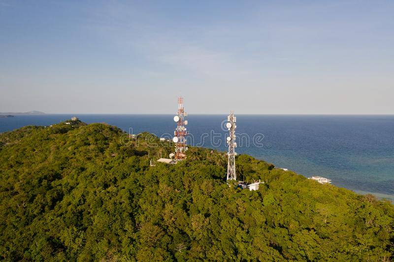 Telecommunication tower, communication antenna. Landscape with hills and rainforest, view from above. Telecommunication tower, communication antenna. Repeaters stock image