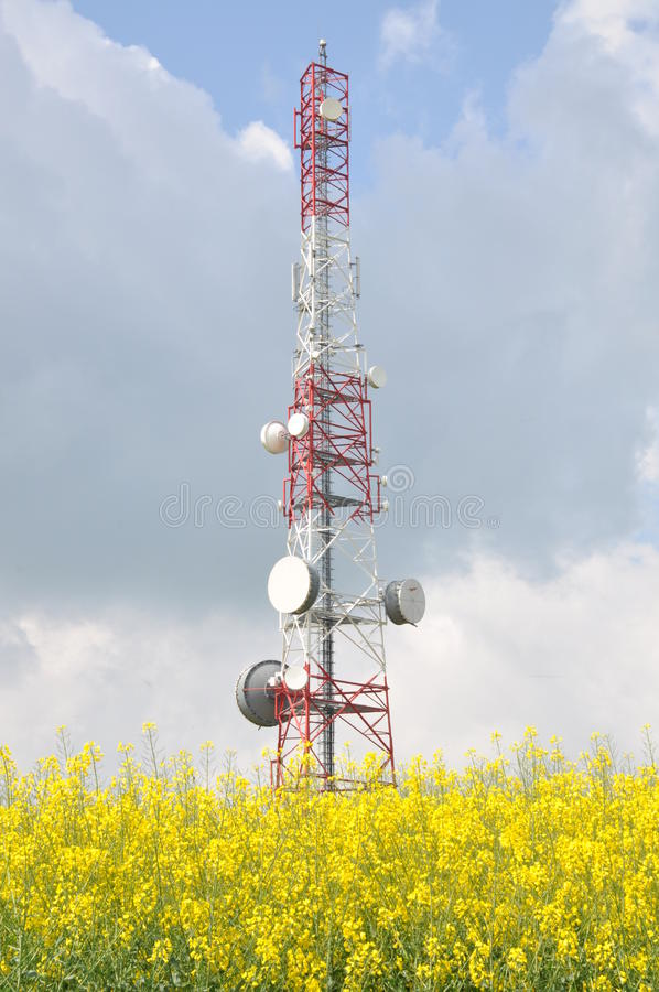 Telecommunication tower on a field royalty free stock images