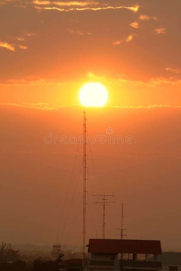 Telecommunication tower in golden sunset. Background royalty free stock photo