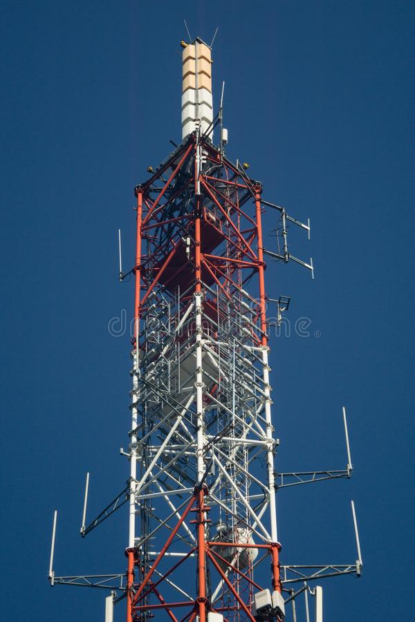 Telecommunication tower. Lattice telecommunication tower with microwave and GSM antennas stock images