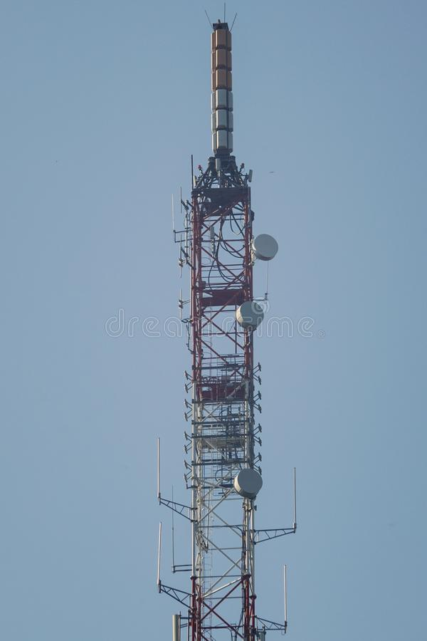 Telecommunication tower. Lattice telecommunication tower with microwave and GSM antennas stock photo