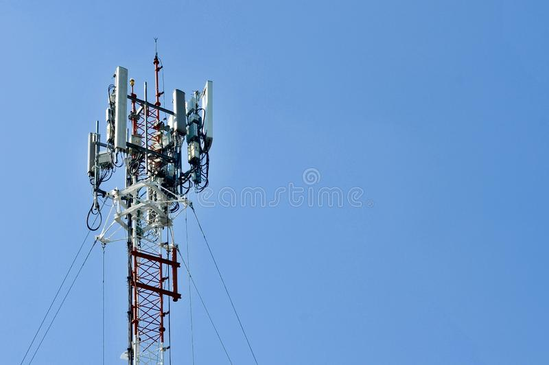 Telecommunication tower mast TV antennas wireless technology, Mobile phone communication tower. Cellular phone antennas area outside the capital.Technology on royalty free stock images