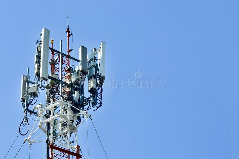 Telecommunication tower mast TV antennas wireless technology, Mobile phone communication tower. Cellular phone antennas area outside the capital.Technology on royalty free stock photos