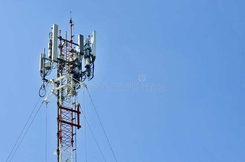 Telecommunication tower mast TV antennas wireless technology, Mobile phone communication tower. Cellular phone antennas area outside the capital.Technology on stock photo