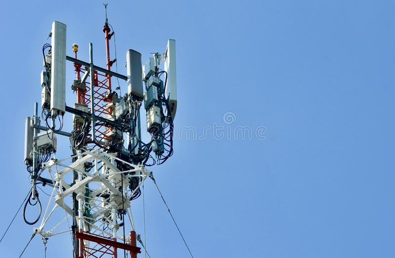 Telecommunication tower mast TV antennas wireless technology, Mobile phone communication tower. Cellular phone antennas area outside the capital.Technology on stock photography