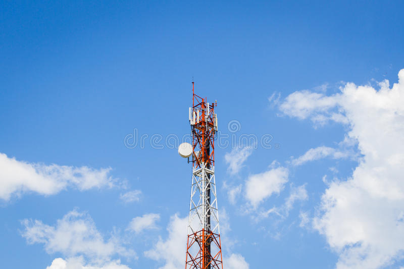 Telecommunication tower in the middle of the picture with cloudy. Blue sky stock photo