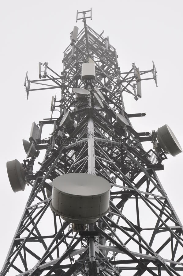 Telecommunication tower in the mist. Telecommunication tower with antennas in the mist royalty free stock images