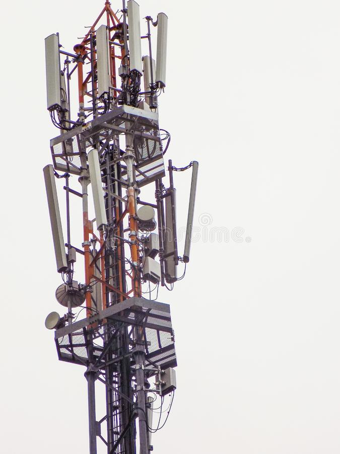 Telecommunication tower of mobile telephone network base station with smart cellular antennas radiating strong signal. Mobile telephone network base station royalty free stock photos