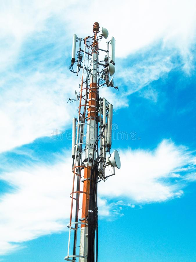 Telecommunication tower of mobile telephone network base station with smart cellular antennas radiating strong signal. Mobile telephone network base station stock photos