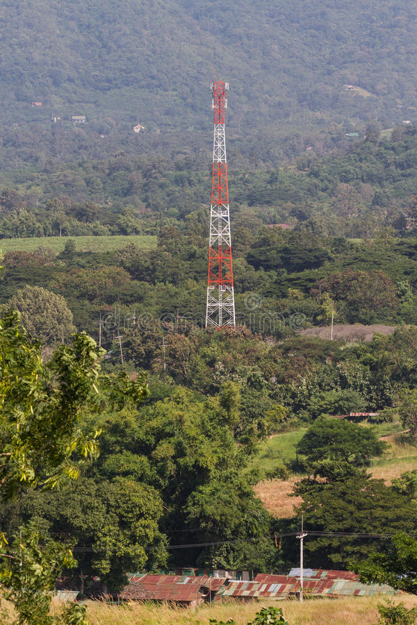 Telecommunication tower in nature. Telecommunication tower among green nature royalty free stock images