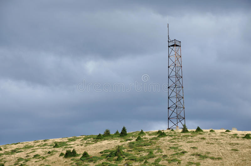 Telecommunication tower in the outdoors. Telecommunication tower on the mountain royalty free stock image