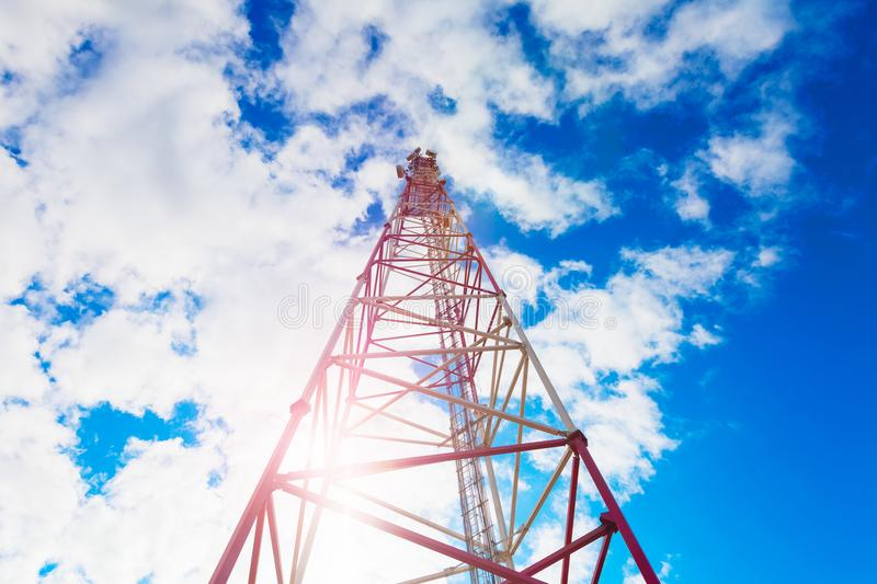 Telecommunication tower with panel antennas and radio antennas and satellite dishes for mobile communications 2G, 3G, 4G royalty free stock image