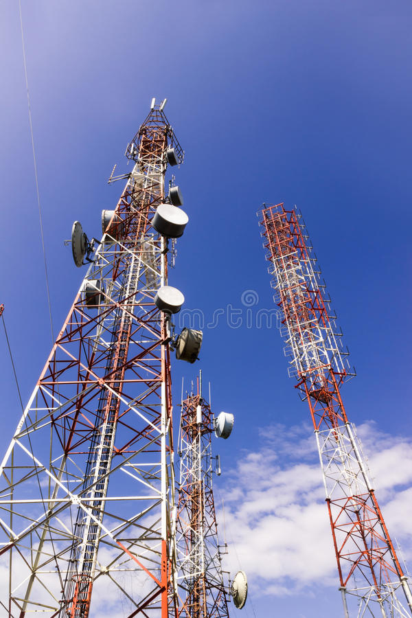 Telecommunication tower , AM radio and TV broadcast tower against blue sky background. Thailand stock photo