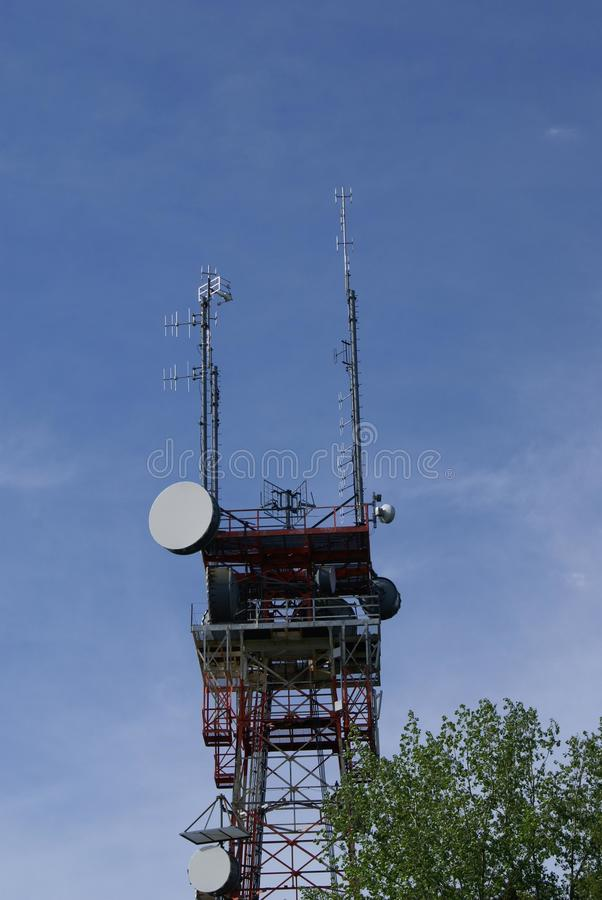 Telecommunication tower. With satellite dishes royalty free stock photo