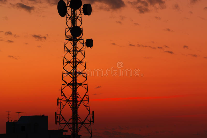 Telecommunication tower. Structure with sunset sky background royalty free stock image