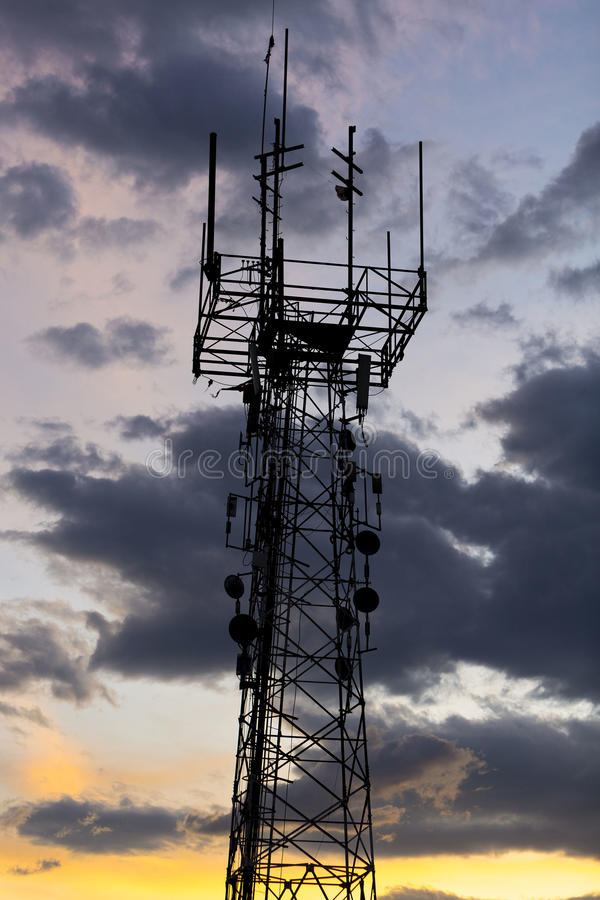 Telecommunication tower during sunset. Medellin, Colombia. Silhouette of telecommunication tower over sunset in Medellin, Colombia royalty free stock image