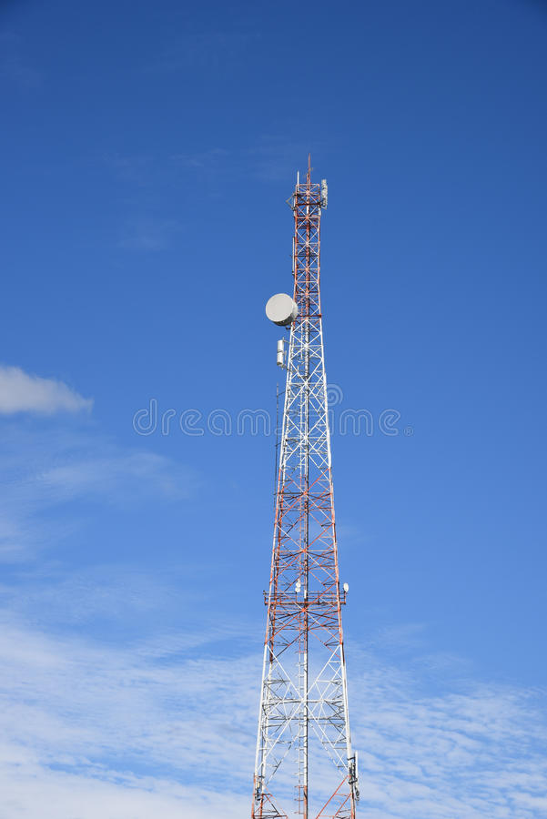 Telecommunication tower and telephone pole. Telecommunication tower & x28;transmitter, sender& x29;, broadcast, television & x28;TV& x29; and telephone pole stock image