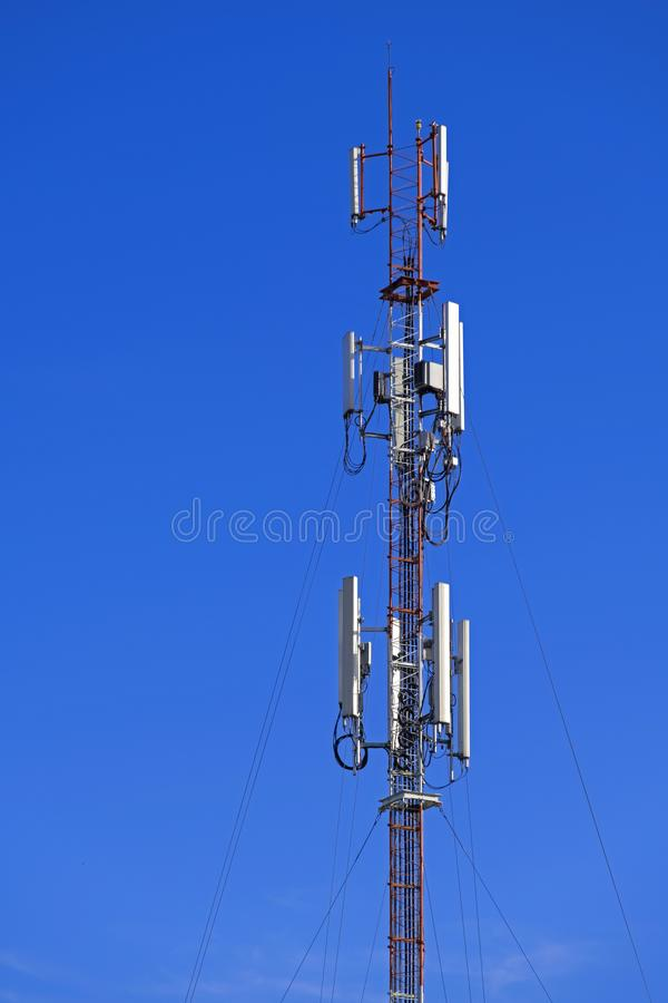 The pole of telecommunication telephone signal transmission tower with blue sky background. The telecommunication tower to transmission data mobile phone or any royalty free stock photo
