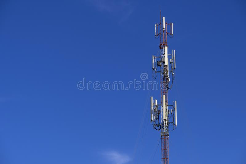 The pole of telecommunication telephone signal transmission tower with blue sky background. The telecommunication tower to transmission data mobile phone or any royalty free stock images