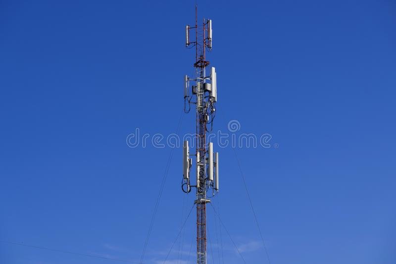 The pole of telecommunication telephone signal transmission tower with blue sky background. The telecommunication tower to transmission data mobile phone or any stock photography