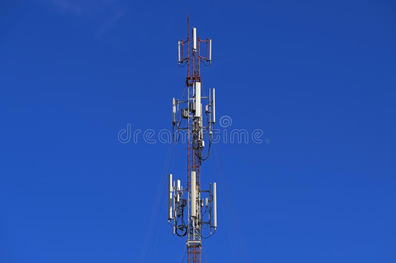 The pole of telecommunication telephone signal transmission tower with blue sky background. The telecommunication tower to transmission data mobile phone or any royalty free stock photography