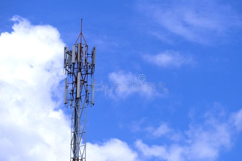 The pole of telecommunication telephone signal transmission tower with blue sky and cloud background. The telecommunication tower to transmission data mobile stock photo