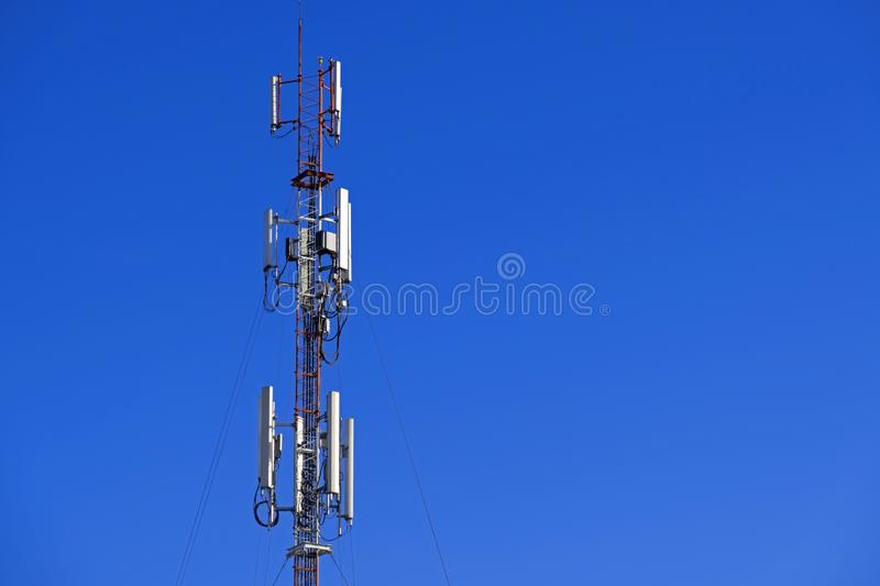 The pole of telecommunication telephone signal transmission tower with blue sky background. The telecommunication tower to transmission data mobile phone or any royalty free stock photos