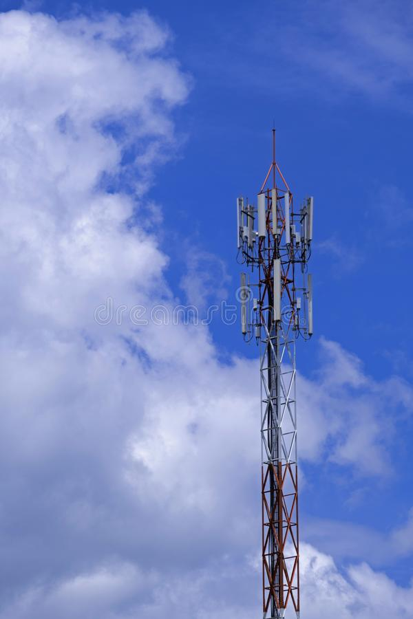 The pole of telecommunication telephone signal transmission tower with blue sky and cloudy background stock images