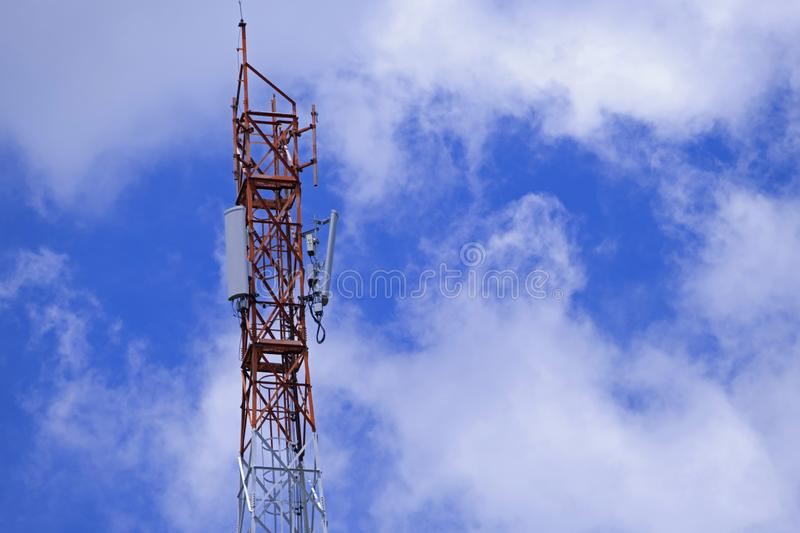 The pole of telecommunication telephone signal transmission tower with blue sky and cloudy background. The telecommunication tower to transmission data mobile royalty free stock image
