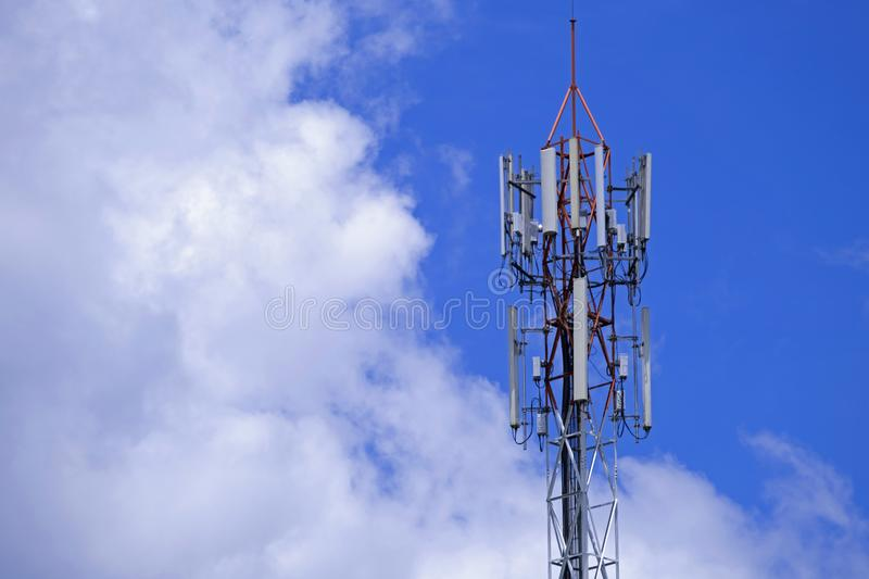The pole of telecommunication telephone signal transmission tower with blue sky and cloudy background. The telecommunication tower to transmission data mobile royalty free stock photography