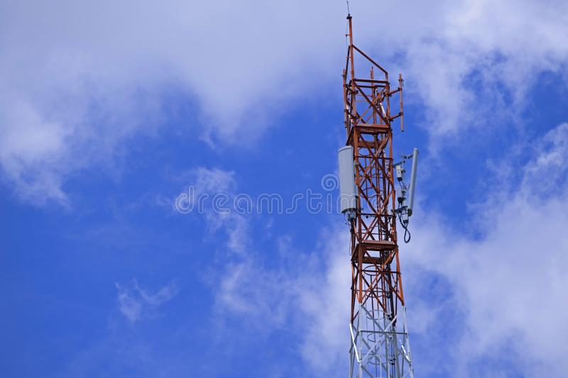 The pole of telecommunication telephone signal transmission tower with blue sky and cloudy background. The telecommunication tower to transmission data mobile stock images