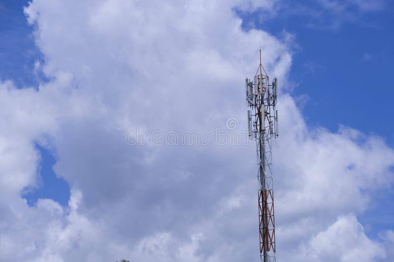 The pole of telecommunication telephone signal transmission tower with blue sky and cloudy background. The telecommunication tower to transmission data mobile royalty free stock images