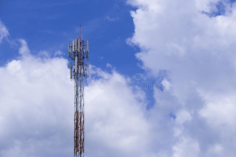 The pole of telecommunication telephone signal transmission tower with blue sky and cloudy background. The telecommunication tower to transmission data mobile royalty free stock photos