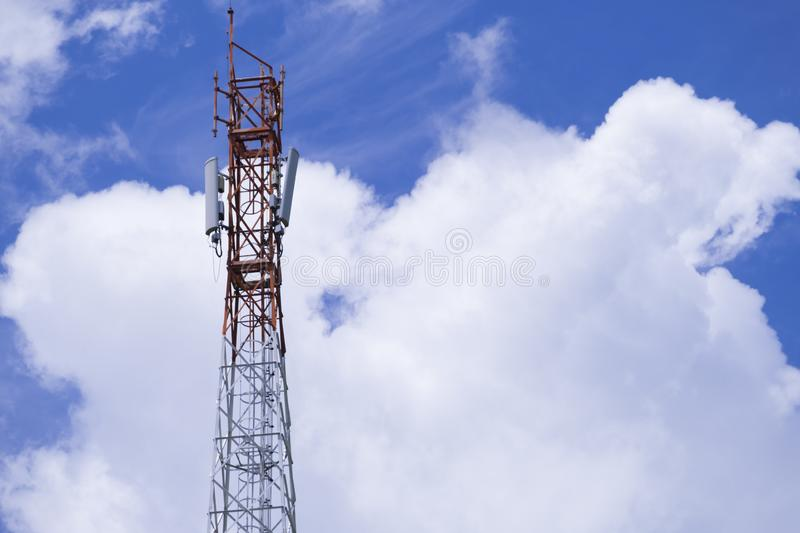 The pole of telecommunication telephone signal transmission tower with blue sky and cloudy background. The telecommunication tower to transmission data mobile stock image
