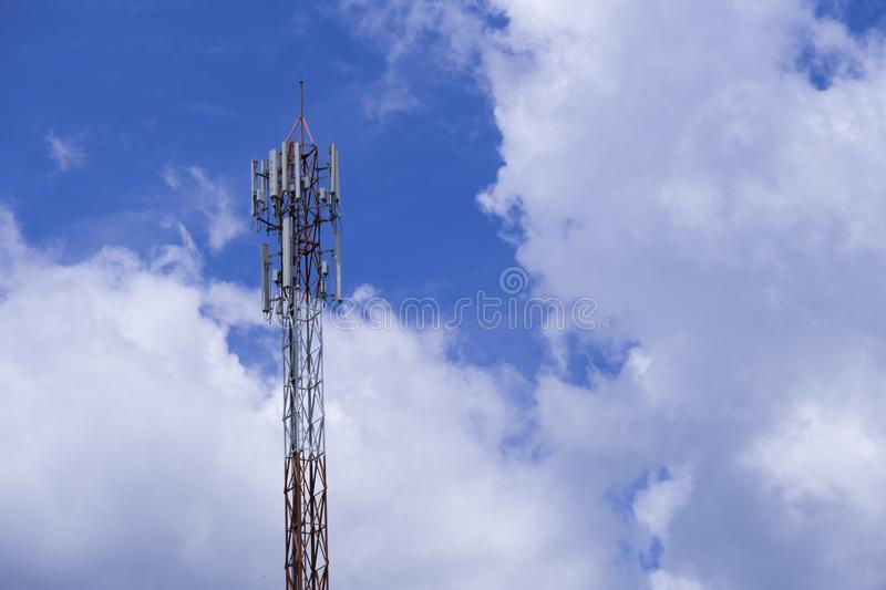 The pole of telecommunication telephone signal transmission tower with cloudy and blue sky. The telecommunication tower to transmission data mobile phone or any stock images