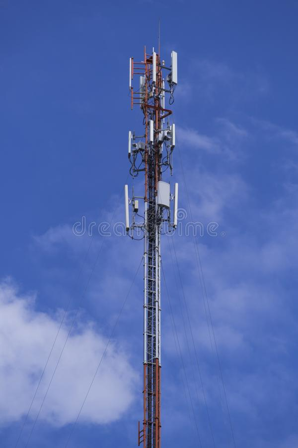 The pole of telecommunication telephone signal transmission tower with cloudy and blue sky. The telecommunication tower to transmission data mobile phone or any royalty free stock photography