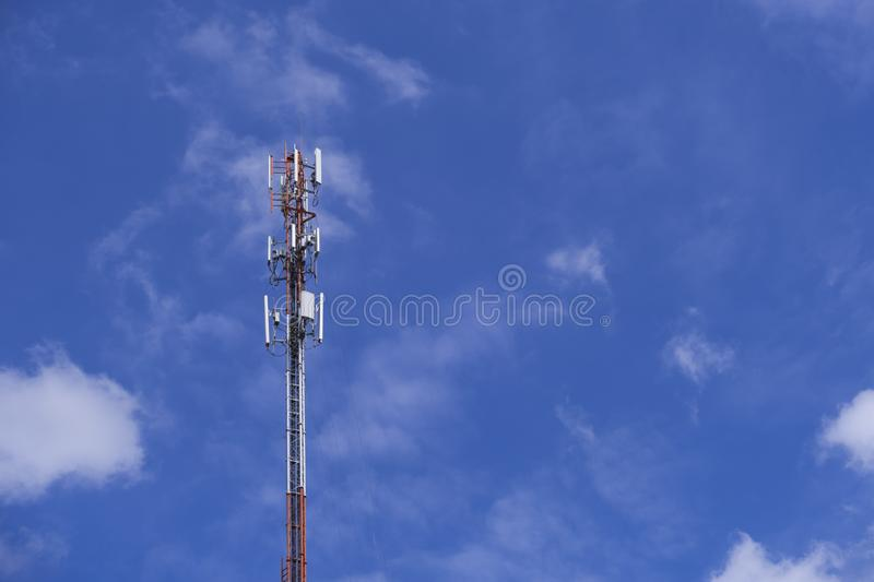 The pole of telecommunication telephone signal transmission tower with cloudy and blue sky. The telecommunication tower to transmission data mobile phone or any royalty free stock image