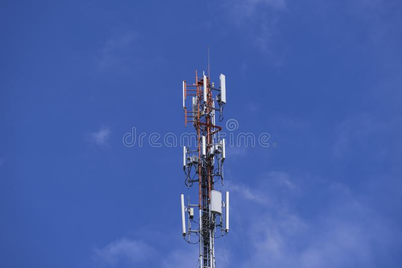 The pole of telecommunication telephone signal transmission tower with cloudy and blue sky. The telecommunication tower to transmission data mobile phone or any royalty free stock photos
