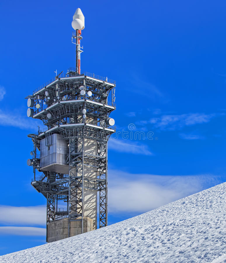 Telecommunication tower on the top of Mt. Titlis. Mt. Titlis, Switzerland - 12 October, 2015: telecommunication tower on the top of the mountain. Titlis (also royalty free stock photo