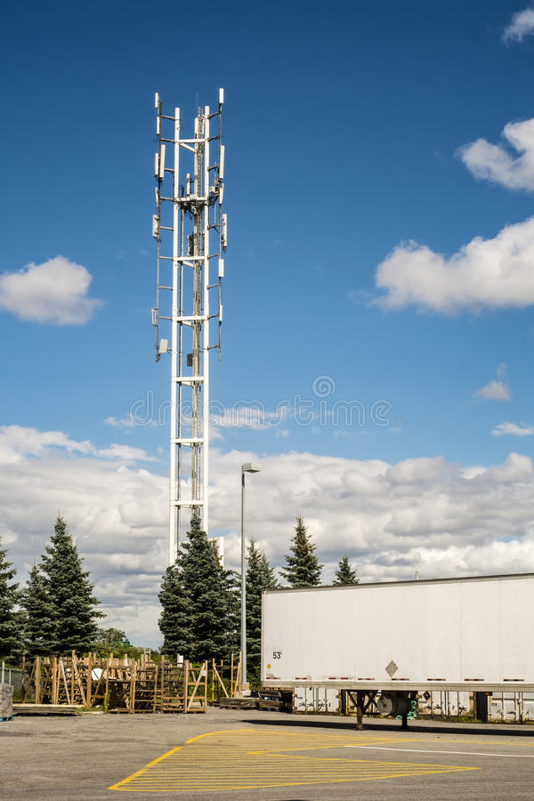 Telecommunication tower. With TV transmitter antennas over a beautiful blue sky with clouds royalty free stock photo