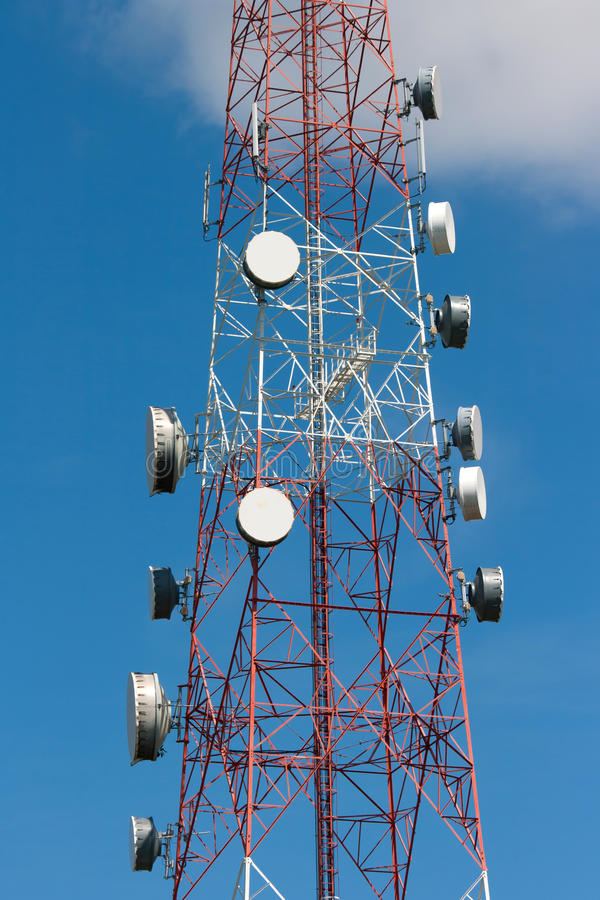 Telecommunication tower. Under blue sky royalty free stock photo