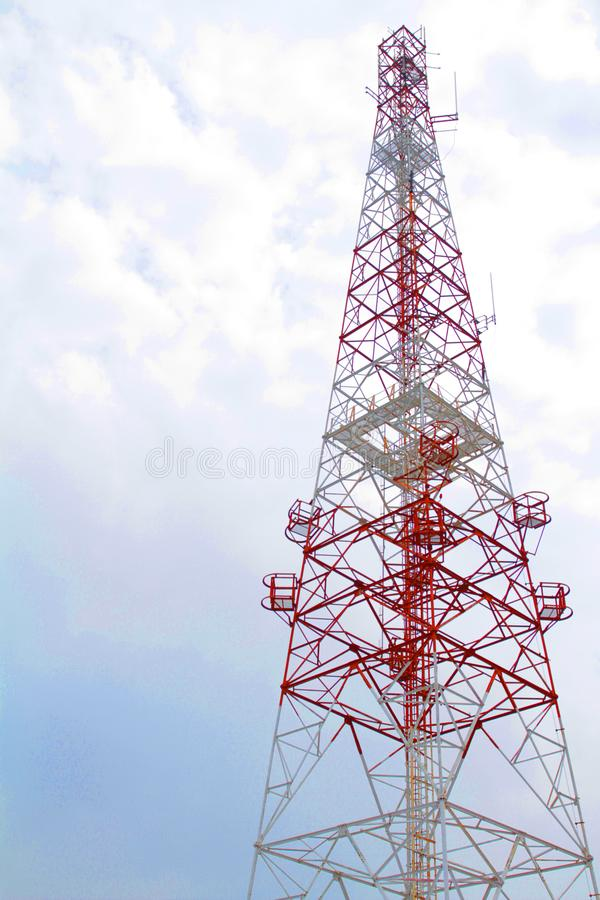 A telecommunication tower was showed clear red line stand out from white sky in day time. A telecommunication tower was showed clear red lines stand out from stock images