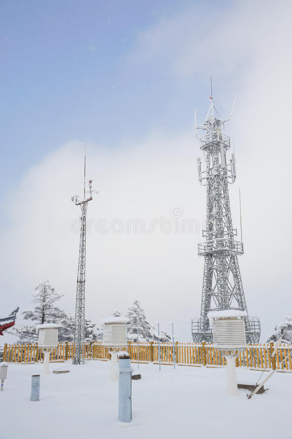 Telecommunication tower and weather station. Telecommunication tower weather station in the winter, at mt. emei stock image