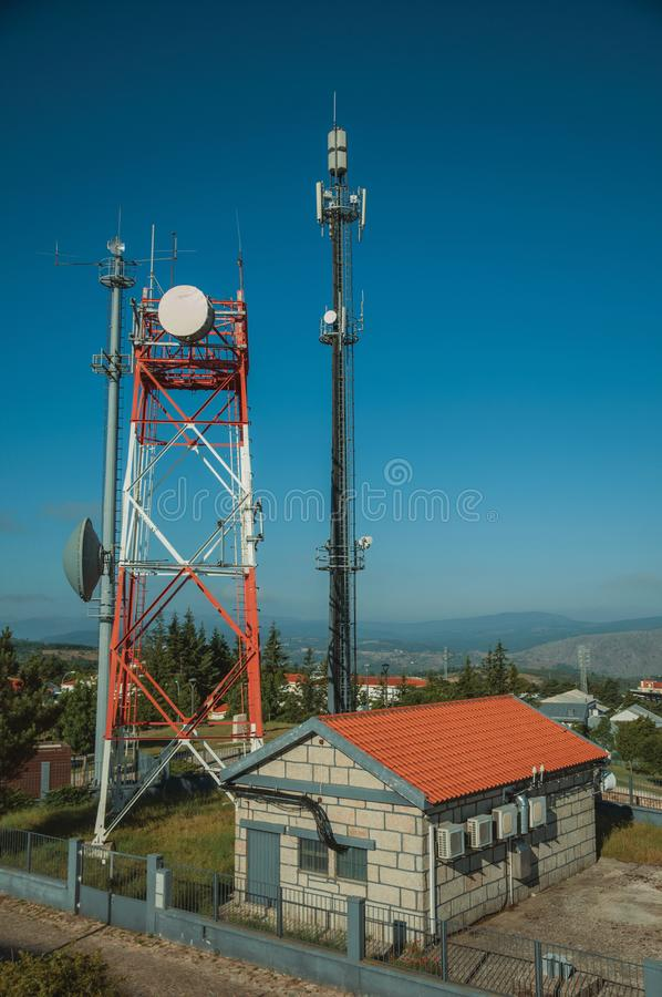 Telecommunication towers on a base transceiver station. Telecommunication cellular network towers with antennas on a base transceiver station, in a sunny day at royalty free stock photos