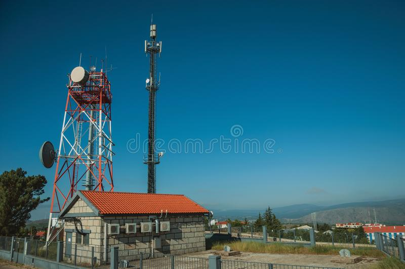Telecommunication towers on a base transceiver station. Telecommunication cellular network towers with antennas on a base transceiver station, in a sunny day at stock photos