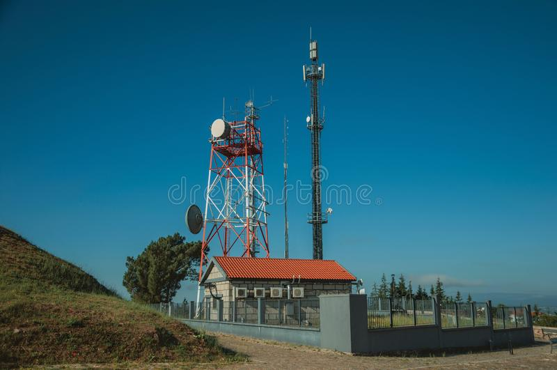 Telecommunication towers on a base transceiver station. Telecommunication cellular network towers with antennas on a base transceiver station, in a sunny day at stock images