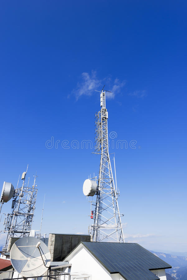 Telecommunication Towers on Blue Sky stock images