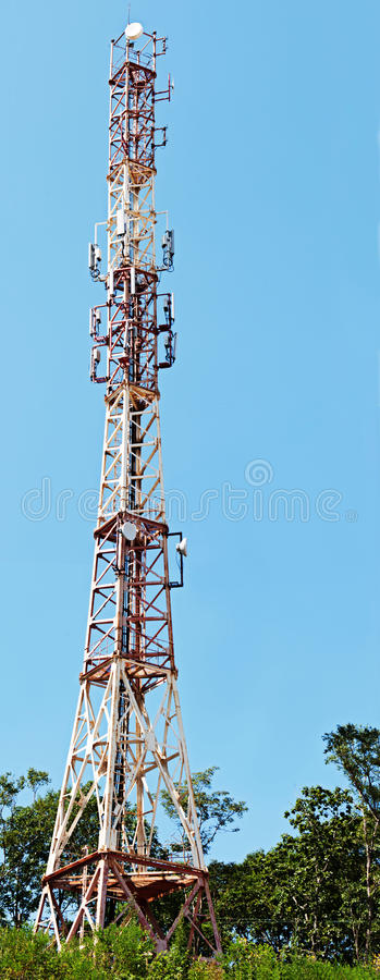 Telecommunication towers with deep blue sky. Closeup stock photography