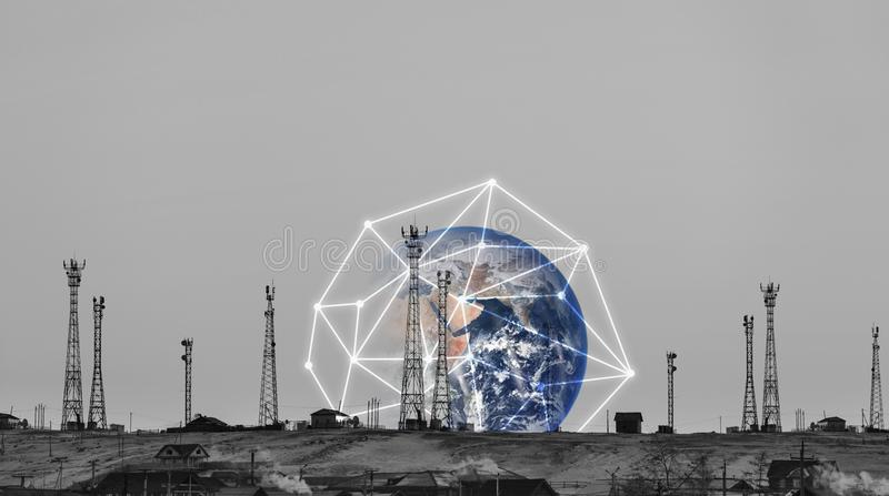 Telecommunication towers with global network connection. Element of this image are furnished by NASA royalty free stock photos